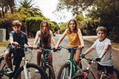 Bicycle Gang. Of boys and girls. Kids playing with their bicycles outdoors stock photos
