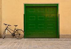 Bicycle at a garage Royalty Free Stock Photography