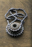 Bicycle gear cogwheel. And chain over wooden surface Stock Photos