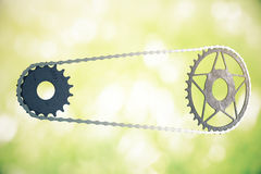 Bicycle gearing on green background Stock Photo