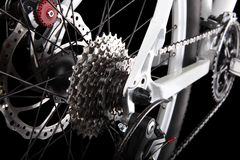 Bicycle gears, disc brake and rear derailleur. Studio shot on black background Stock Images