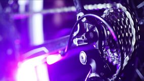 Bicycle gears mechanism on the rear wheel. Close up of working bicycle gears mechanism on the rear wheel stock footage