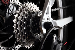 Bicycle gears and rear derailleur. Studio shot on black background Royalty Free Stock Photos