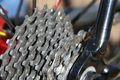 Bicycle gears and sprockets. A closeup view of the gears and sprockets on a variable speed bicycle Royalty Free Stock Photos