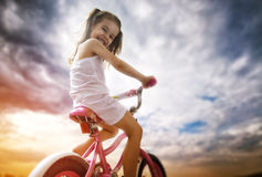 Bicycle. A girl goes on a Bicycle Stock Image