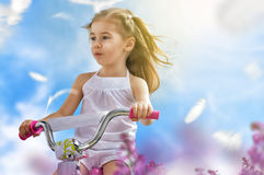 Bicycle. A girl goes on a Bicycle Stock Photography