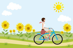 Bicycle girl on sunflowers Stock Photography