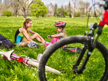 Bicycle girls wearing helmet. They have rest from cycling. Royalty Free Stock Photography
