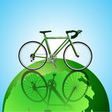 Bicycle on the globe ecology background Stock Photo