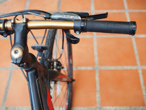 Bicycle golden hand handlebar grip on tile floor royalty free stock images