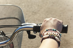 Bicycle hand. The hand holding the handlebar Royalty Free Stock Images