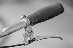 Bicycle handle bar and retro filter. Black and white image with Stock Images