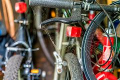 Bicycle handle with dusty spider web in a garage stock image