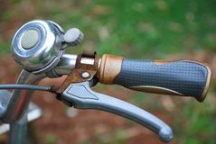 Bicycle handle. A photo taken on the handle of a bicycle with the hand brake lever Stock Photo