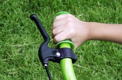 Bicycle handlebar hands. On handlebars bicycle handlebar Stock Images