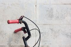 Bicycle handlebar incomplete wall background. Royalty Free Stock Photos