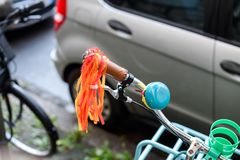 Bicycle handlebar steering with vintage blue horn Royalty Free Stock Photos