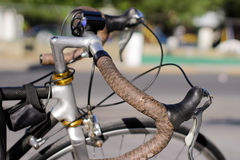 Bicycle handlebars and blurred background. Photograph of a pair of bicycle handlebars and blurred background Stock Photo