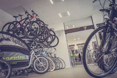 Bicycle Hanged and Piled on Bicycle Shop Stock Images