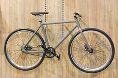 Bicycle hanged on wall. Bicycle hanged on wooden wall in small space apartment Stock Photo