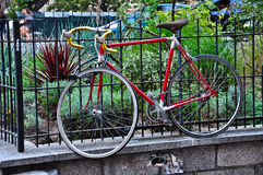 Bicycle hanging on the fence. Royalty Free Stock Photography