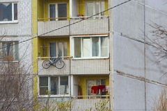 Bicycle hanging outside. Of a residential building Royalty Free Stock Image