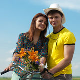 Bicycle & happy couple having fun outdoors Royalty Free Stock Photos