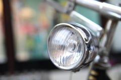 Bicycle headlamp. Crome vintage bicycle headlamp with blurred background Stock Image