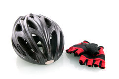 Bicycle helm with cycle gloves. Isolated on white background royalty free stock image