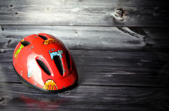 Bicycle helmet. In front of a wooden background Royalty Free Stock Images