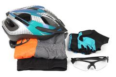 Bicycle helmet, glasses and clothing on white background
