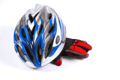 Bicycle helmet and gloves. A cross-country bicycle helmet and gloves royalty free stock image