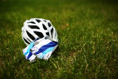 Bicycle helmet on grass Royalty Free Stock Photography
