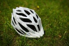 Bicycle helmet on grass Stock Photos