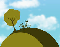 Bicycle on hill vector Stock Photography