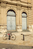 Bicycle and historical building Stock Photos