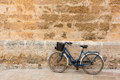 Bicycle in historical Ciutadella stone wall at Balearics Stock Photos