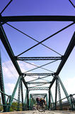 Bicycle on Historical Iron Bridge, Cloudy and Blue Sky Stock Photos