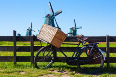 The bicycle in Holland. Clear and traditional landmark for Holland: bicycle and mills stock photography