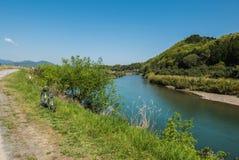 A bicycle by Hozugawa River. A bicycle along the tracks by the shallow area of Hozugawa River. Arashiyama, Kyoto. Japan Stock Images