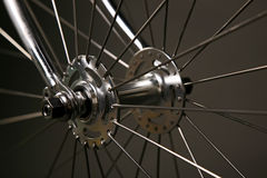 Bicycle hub. Close up of classic Bicycle wheel hub with grey background royalty free stock photo
