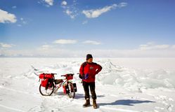 bicycle on the ice of Baikal, a walk with a bicycle through the winter Baikal royalty free stock photo