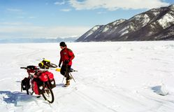 Bicycle on the ice of Baikal, a walk with a bicycle through the winter Baikal stock photo