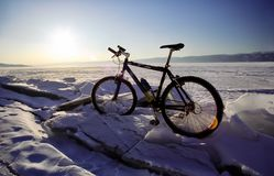 bicycle on the ice of Baikal, a walk with a bicycle through the winter Baikal royalty free stock images