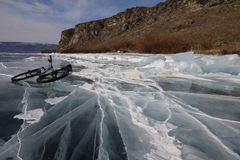Bicycle in iced Baikal lake near island royalty free stock photography