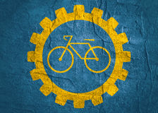 Bicycle icon in gear. Minimalistic sign on concrete textured background. Trendy Flat style for graphic design Royalty Free Stock Photos