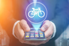 Bicycle icon over device - Sport and technology concept Royalty Free Stock Images