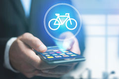 Bicycle icon over device - Sport and technology concept Royalty Free Stock Photography