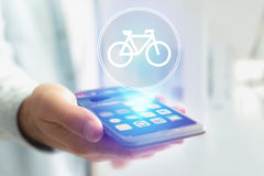 Bicycle icon over device - Sport and technology concept. View of a Bicycle icon over device - Sport and technology concept stock photo