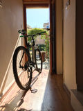 Bicycle indoor home at open door entrance Stock Images